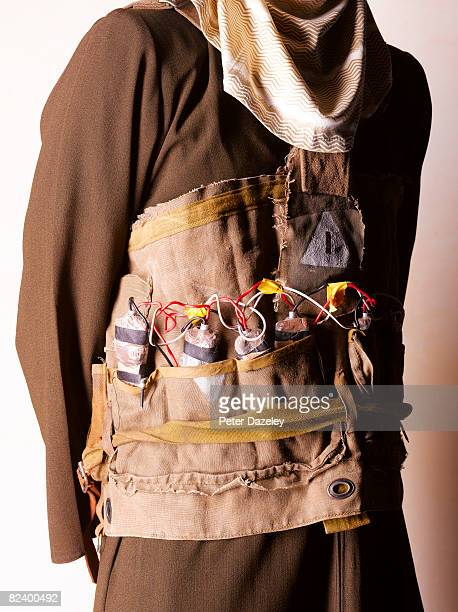 suicide bomber with vest - detonator stock photos and pictures