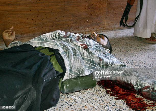 A suicide bomber wrapped with an explosive belt lies dead on the floor killed before blowing himself up by Iraqi security guards at the headquarters...