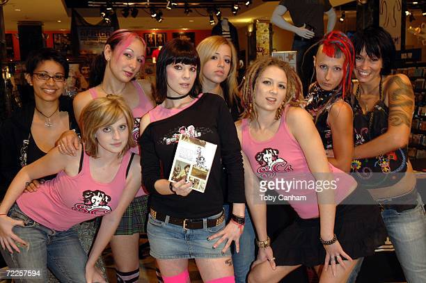 Suicide Girls Alexsandria Rigel Jersey Sorrow Sash Page Reina and Toy pose with copies of their new DVD Italian Villa at a special signing held at...
