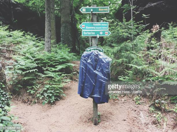 Suit And Information Signs At Forest