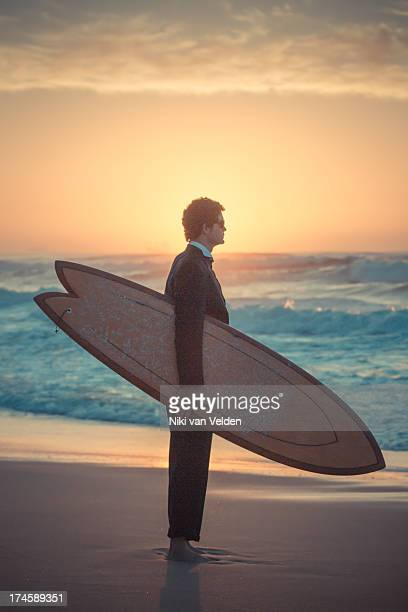 suit and surf 1 - durban beach stock photos and pictures