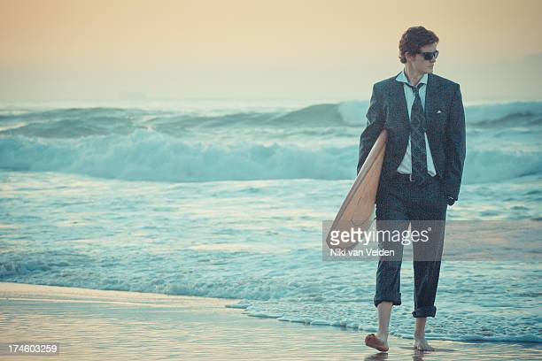 suit and surf 4 - durban beach stock photos and pictures