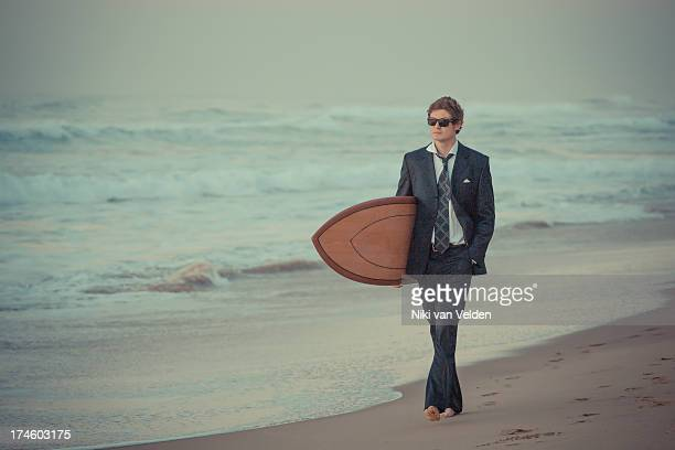suit and surf 5 - durban beach stock photos and pictures