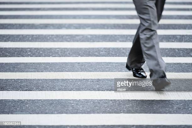 Suit crossing street, motion blur