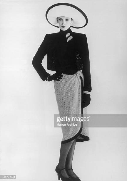 A suit from the Nina Ricci Autumn/Winter 19823 collection 26th July 1982 A black velvet bolero is worn over a wraparound skirt in black and white...
