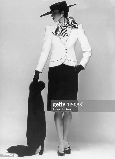 A suit from the Pierre Balmain Spring/Summer 1983 collection 26th January 1983 A white jacket is worn over a black woolen skirt and a black and white...