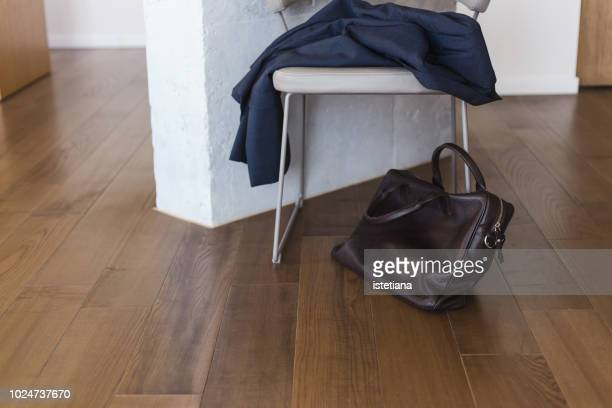 suit jacket and brown leather briefcase - coat stock pictures, royalty-free photos & images