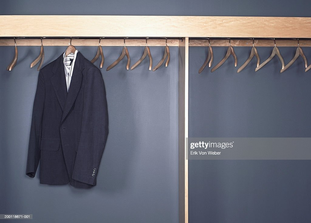 Suit jacket and shirt hanging in office cubby : Stock Photo