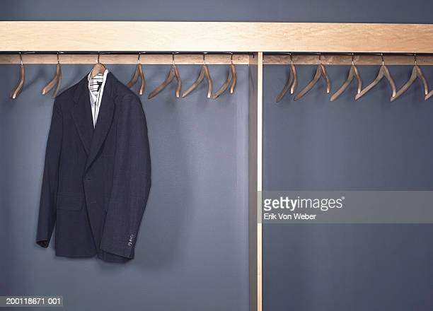 Suit jacket and shirt hanging in office cubby