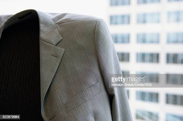 suit jacket draped on an office chair - coat photos et images de collection