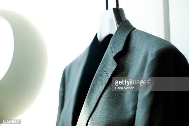 A suit jacket hanging in a hotel room