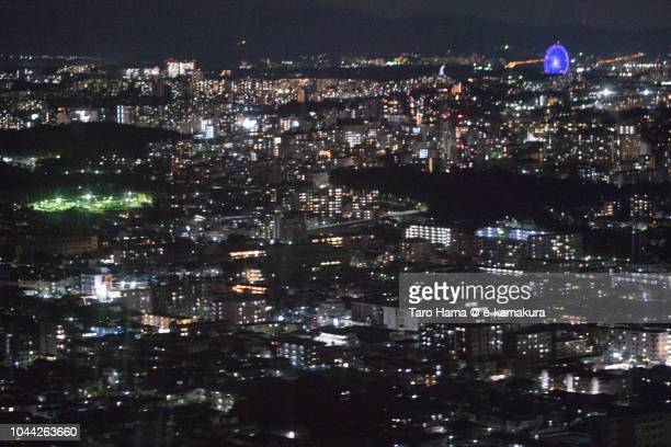 Suita and Toyonaka cities in Osaka prefecture in Japan night time aerial view from airplane