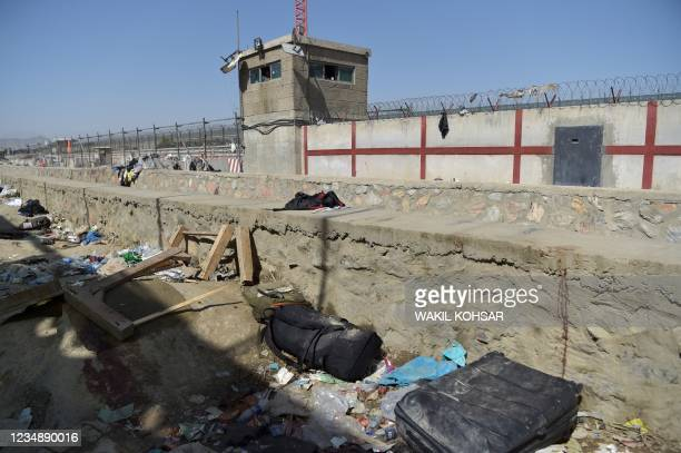 Suitcase and backpacks of Afghan people who were waiting to be evacuated are seen at the site of the August 26 twin suicide bombs, which killed...