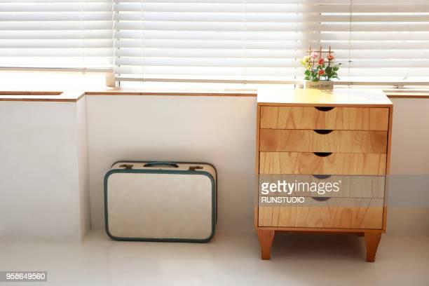 suitcase and chiffonier - 引き出し ストックフォトと画像