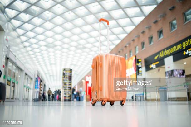 suitcase at airport - luggage stock pictures, royalty-free photos & images