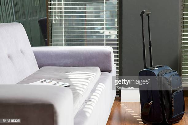 Suitcase by a couch in an office