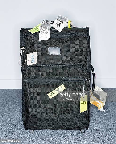 Suitcase covered in labels