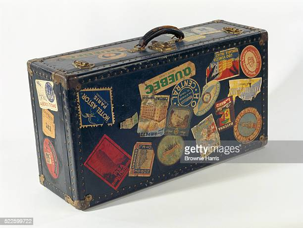 Suitcase Covered in Stickers