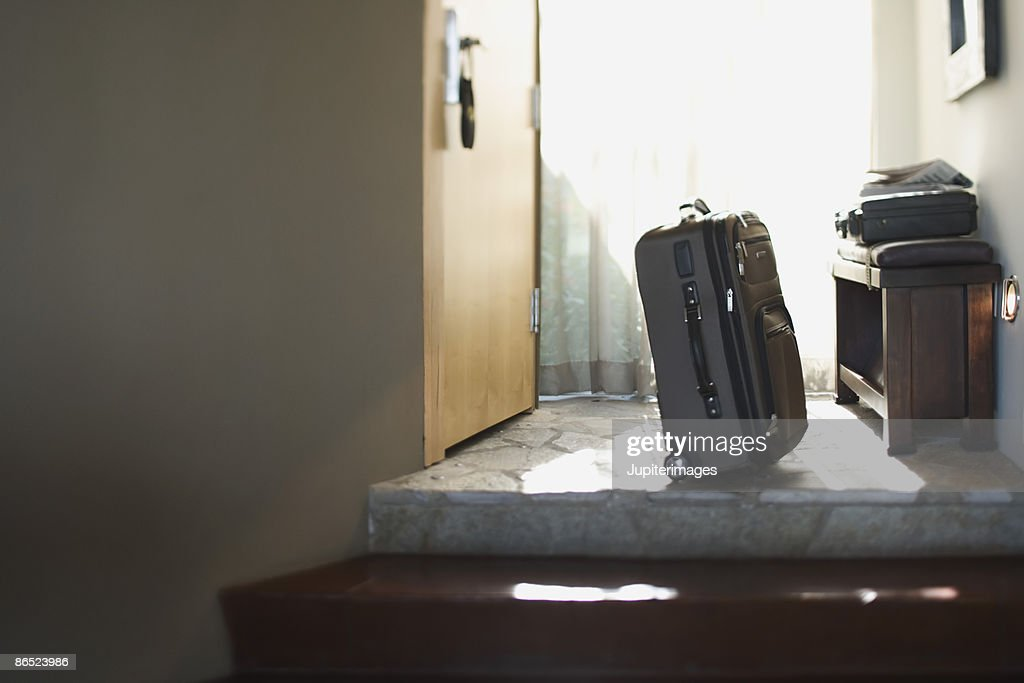 Suitcase in doorway : Stock Photo