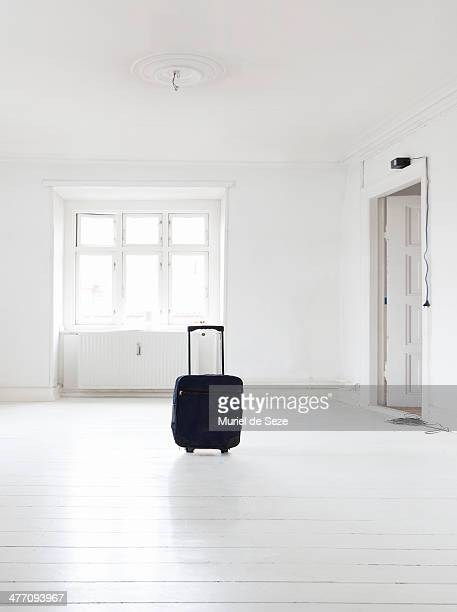 Suitcase in empty apartment