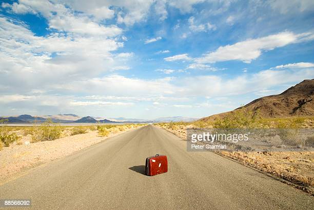 Suitcase in middle of desert