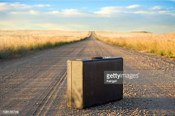 Suitcase in middle of the road
