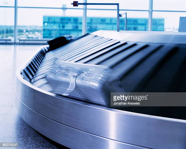 Suitcase On a Moving Carousel
