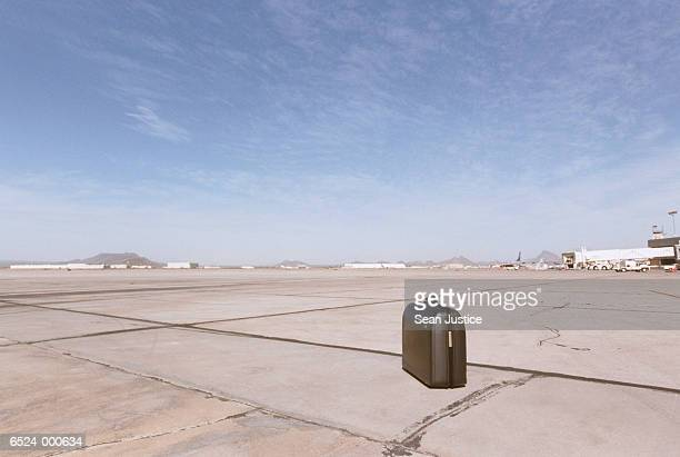 Suitcase on Airport Runway