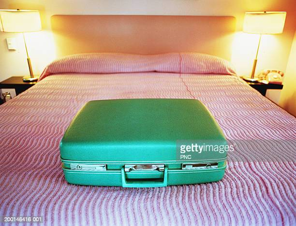 Suitcase on bed