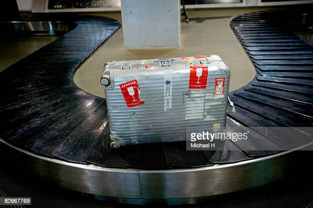 suitcase on belt conveyer of luggage substitution - fragile sign stock pictures, royalty-free photos & images