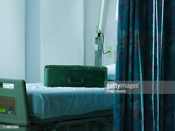 Suitcase on hospital bed