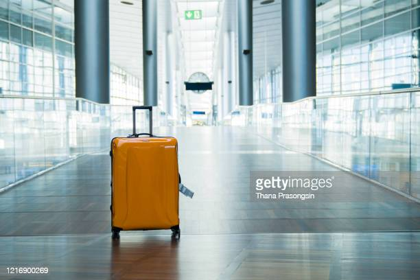 suitcase or baggage with airport luggage trolley in the international airport - travel stock pictures, royalty-free photos & images