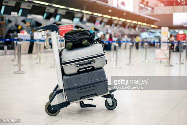 Suitcase or baggage with airport luggage trolley in the international airport.