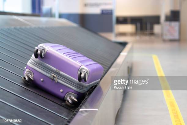 suitcase or luggage with conveyor belt in the airport. lost luggage - baggage claim stock pictures, royalty-free photos & images