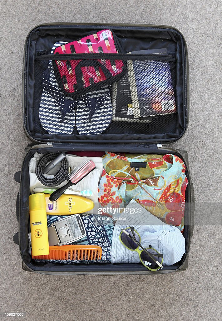 Suitcase packed for vacation : Foto stock