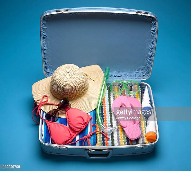 Suitcase Packed with Beach Wear