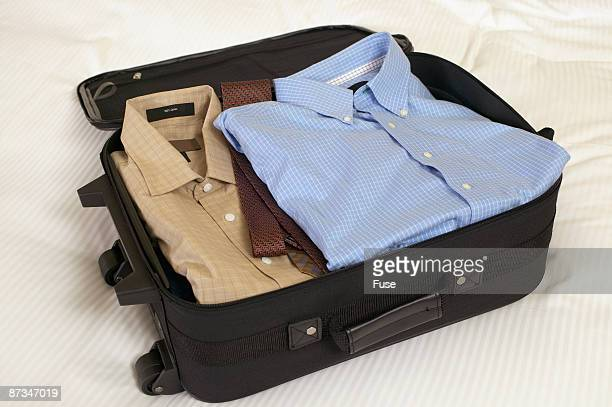 Suitcase packed with neatly folded clothes