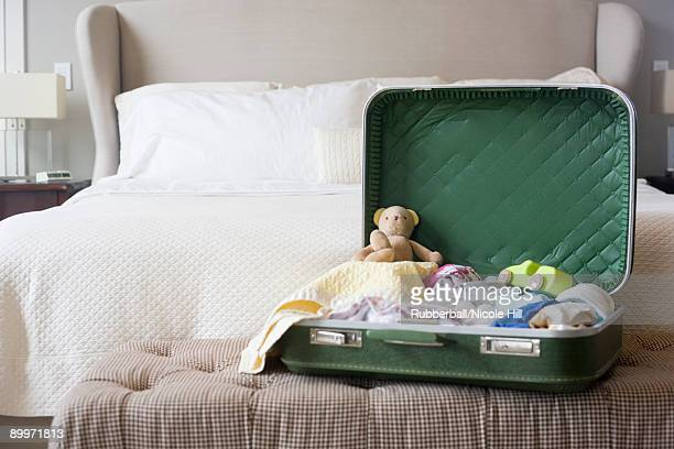suitcase sitting open on a bed