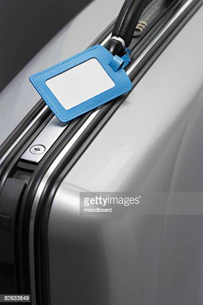 Suitcase with blank tag, close-up