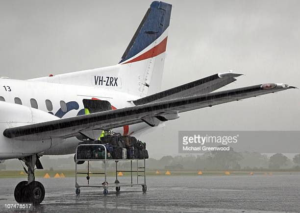 Suitcases and bags get wet while being loaded into the hold of an REX Airlines plane, Orange, Australia.