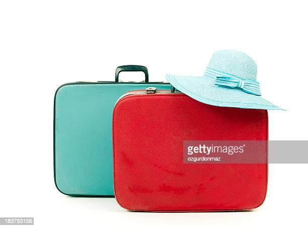 Suitcases and straw hat