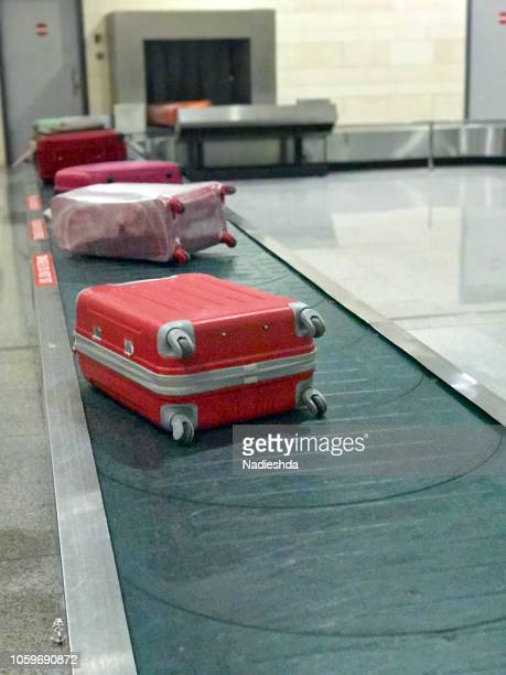 suitcases at airport - baggage claim stock pictures, royalty-free photos & images