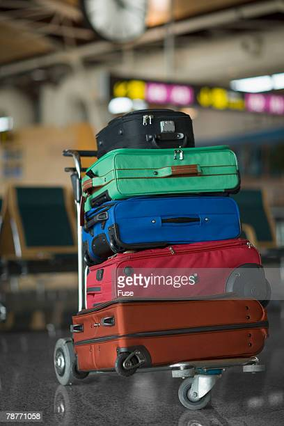 Suitcases on Luggage Cart at the Airport