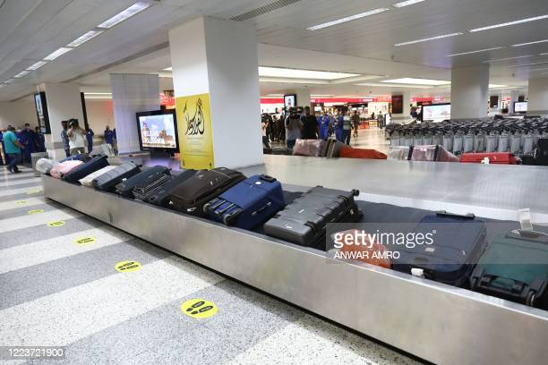 Suitcases turn in the conveyor belt at the arrivals' terminal at Beirut international airport as it re-opens on July 1, 2020 in the Lebanese capital....