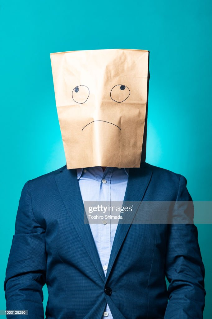 A Suited Man Pull A Paper Bag Over His Head High-Res Stock Photo ...