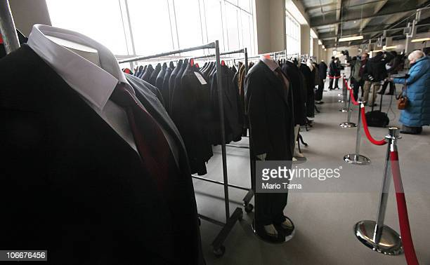 Suits are displayed at a press preview of an auction of 400 pieces of personal property jewelry and antiques from Bernard and Ruth Madoff November 10...