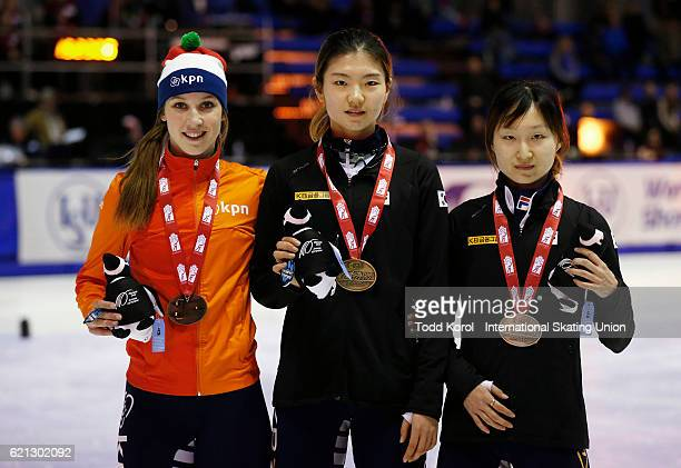 Suk Hee Shim of Korea celebrates her gold medal with teammate Minjeong Choi who won silver and Suzanne Schulting of the Netherlands who won bronze in...