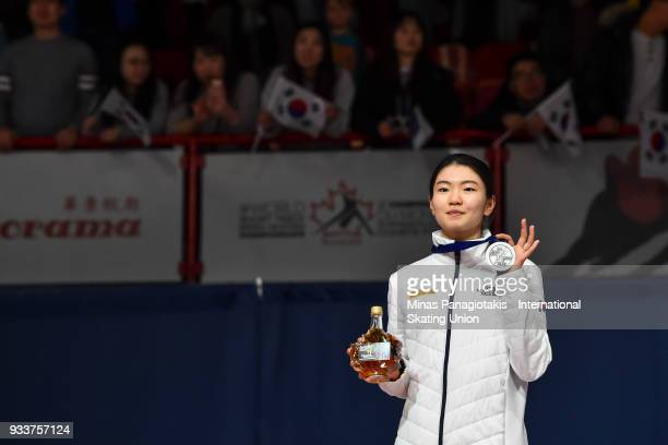 Suk Hee Shim of Korea holds up her silver medal after finishing second overall in the women's 3000 meter SuperFinal during the World Short Track...