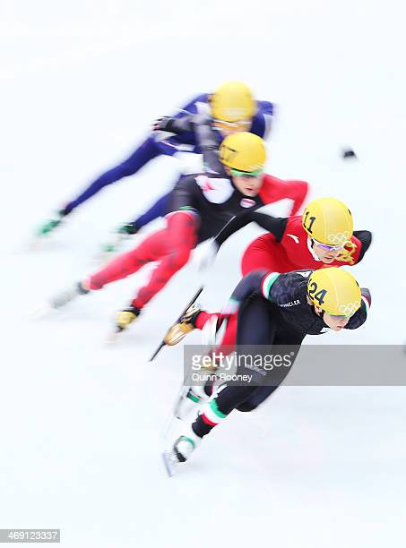Suk Hee Shim of Korea Valerie Maltais of Canada Jianrou Li of China and Arianna Fontana of Italy compete in the Women's Short Track 500m heats on day...