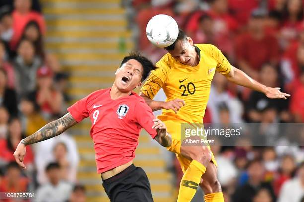Suk Hyunjun of Korea Republic and Trent Sainsbury of Australia compete for the ball during the International Friendly match between the Australian...